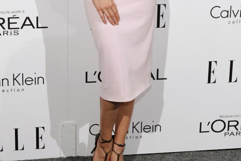 Actress Amber Heard poses at Elle's 18th Annual Women in Hollywood Tribute in Los Angeles
