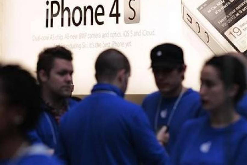 A sign for the iPhone 4S is seen at an Apple Store in New York