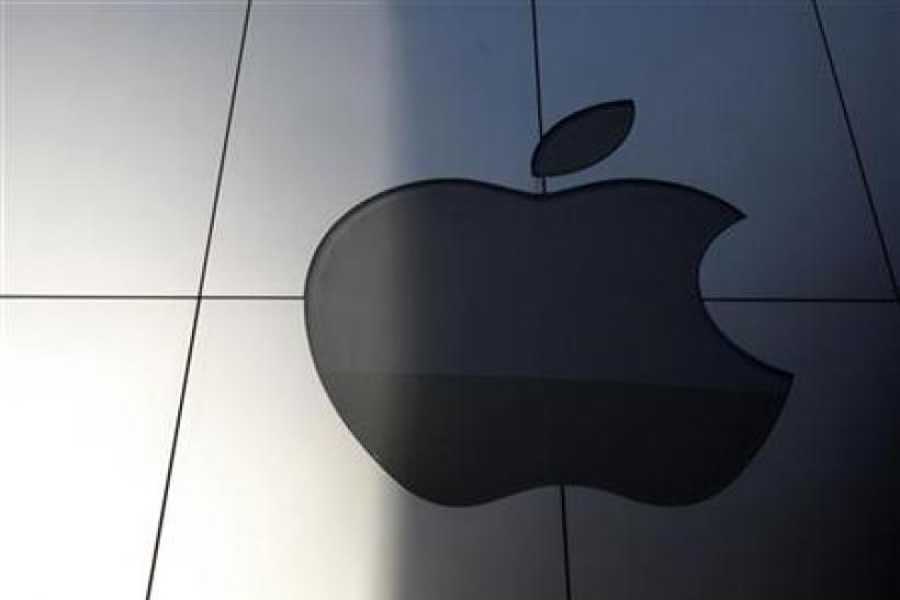An Apple logo is seen with its light switched off to mourn the death of former Apple Inc Jobs, in Tokyo