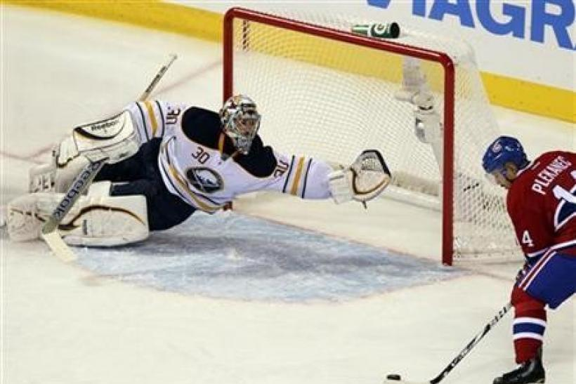 Buffalo Sabres goalie Ryan Miller (30) makes a save on a shot by Montreal Canadiens Tomas Plekanec (14) during second period NHL hockey action in Montreal, October 18, 2011.