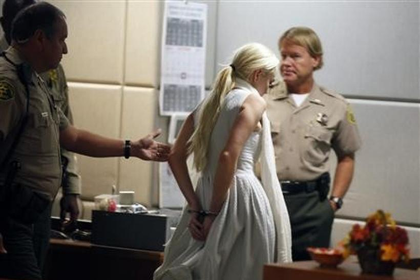Actress Lindsay Lohan is handcuffed after a judge revoked her probation for failing to appear at a series of community service appointment