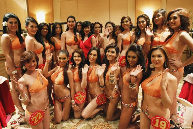 ransvestite and transgender candidates for the Miss Amazing Philippines Beauties 2011 pageant pose for photographers before a media presentation ceremony at a hotel in Manila