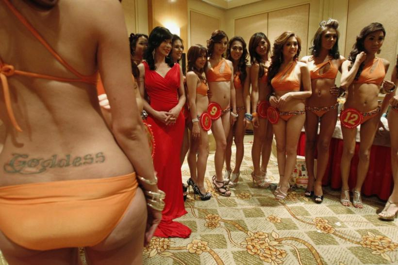 Transvestite and transgender candidates for the Miss Amazing Philippines Beauties 2011 pageant pose for photographers before the start of a media presentation ceremony at a hotel in Manila