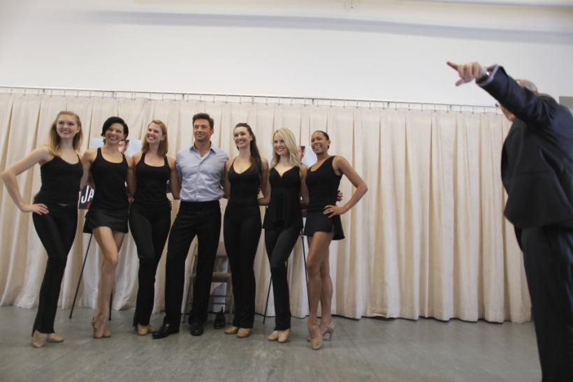 Actor Hugh Jackman poses with dancers for a photograph while promoting his new play, Back on Broadway