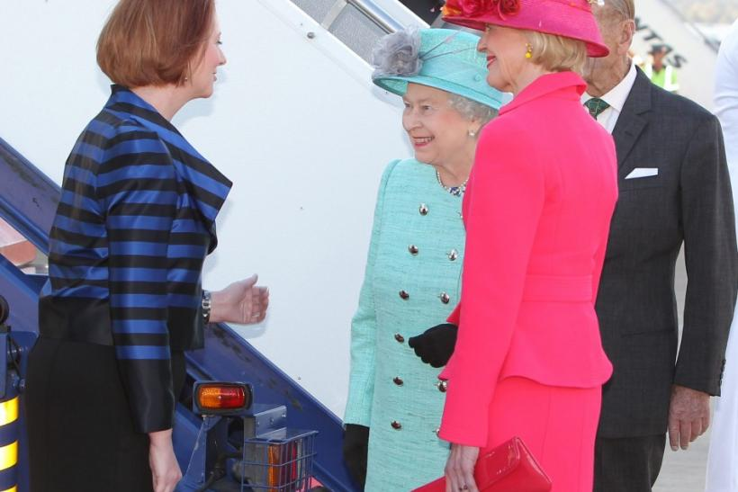 Britain's Queen Elizabeth talks to Australia's Governor General Bryce and PM Gillard after her arrival at Canberra's military airport