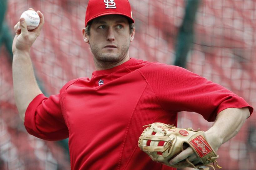 Cardinals' Freese throws during practice before their MLB World Series baseball game in St. Louis