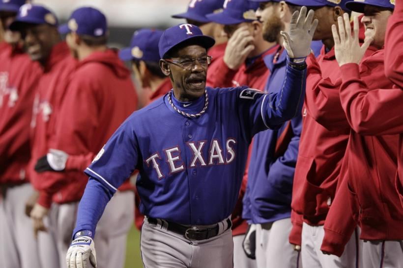 Texas Rangers manager Ron Washington slaps hands with his team before the start of Game 1 of MLB's World Series baseball championship against the St. Louis Cardinals in St. Louis