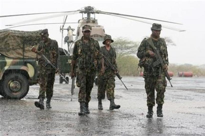Kenyan troops patrol the Garrisa airstrip