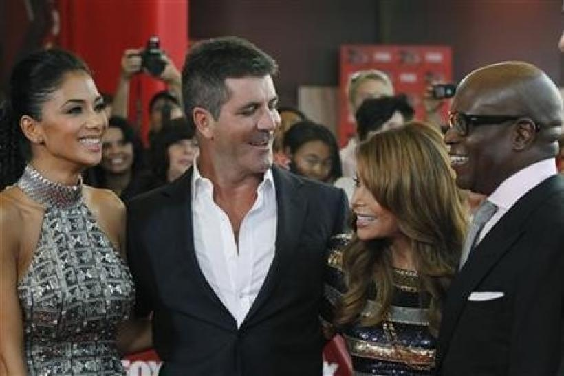 Nicole Scherzinger (L to R), Simon Cowell, Paula Abdul and Antonio Reid attend the world premiere of the television series ''The X Factor'' at the Arclight Cinerama Dome in Hollywood, California