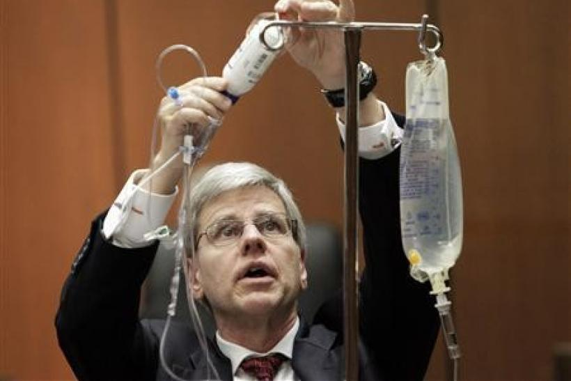 Anesthesiology expert Dr. Steven Shafer demonstrates the use of propofol during his testimony in Dr. Conrad Murray's trial in the death of pop star Michael Jackson in Los Angeles