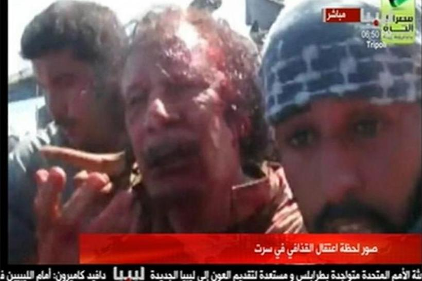 Moammar Gadhafi: Minutes Before He Was Dragged and Killed.