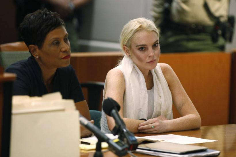Lindsay Lohan sits during a progress report hearing at Airport Branch Courthouse in Los Angeles