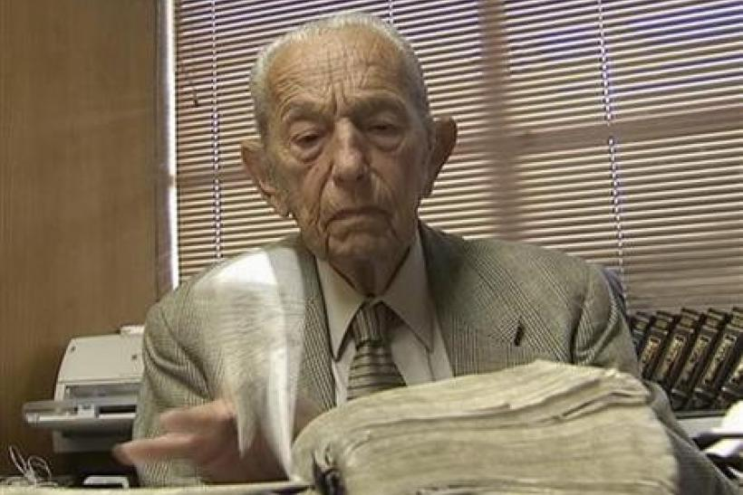 Harold Camping is seen reading the Bible in his office at Family Stations Inc. offices in Oakland, California in this still image from video