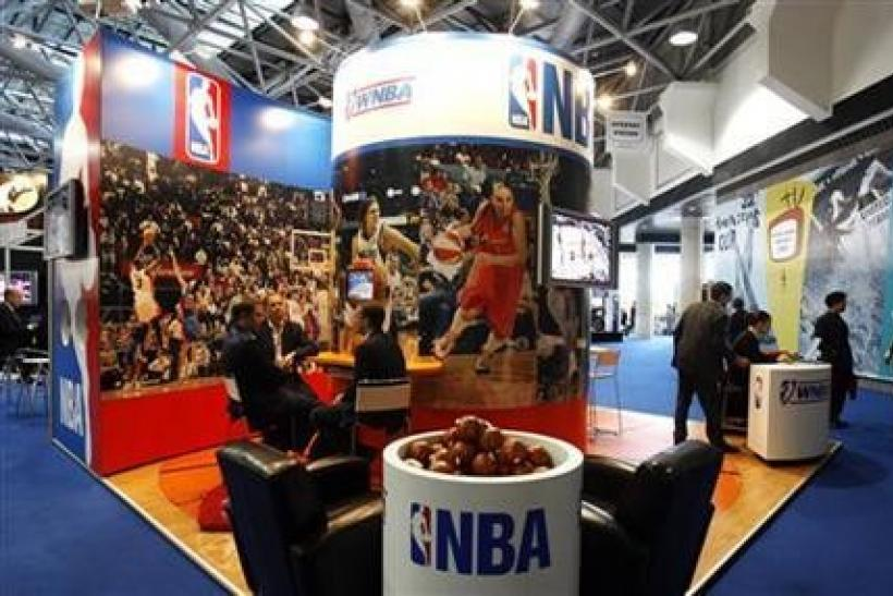 People visit the NBA stand at Sportel 2006 (International Sport Program Market for Television and New Media) in Monte Carlo