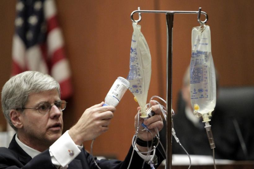 Anaesthesiology expert Dr. Shafer empties bottle of propofol into saline bag as he demonstrates use of propofol during his testimony in Dr. Murray's trial in death of pop star Jackson in Los Angeles