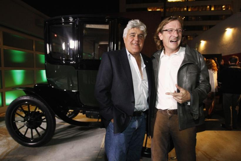 "Television host Jay Leno (L) poses with director Chris Paine at a party after the premiere of the documentary ""Revenge of the Electric Car"" in Los Angeles"