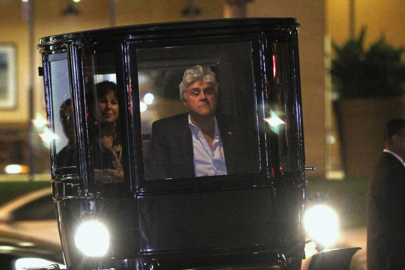 "Television host Jay Leno and his wife Mavis arrive in his 1909 Baker electric car at a party after the premiere of the documentary ""Revenge of the Electric Car"" in Los Angeles"
