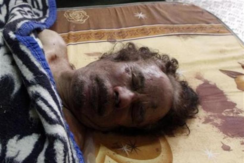 The dead body of Muammar Gaddafi