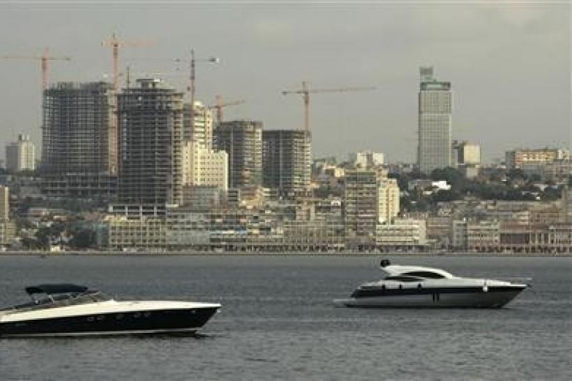 Speedboats sit beneath the backdrop of Luanda