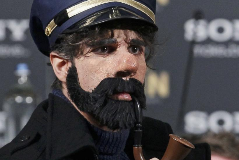 Cast member Daniele Rizzo is dressed as Captain Haddock, his role in the new Tintin movie, in Brussels