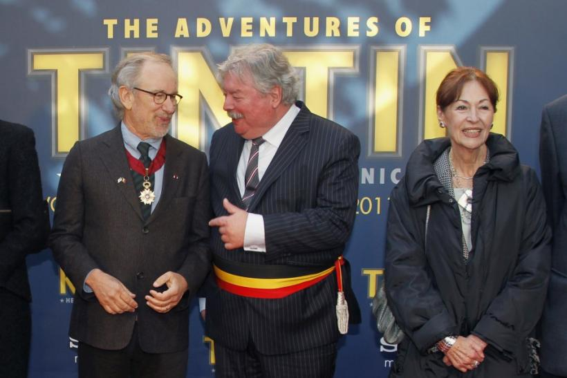 Director Spielberg poses with mayor of Brussels Thielemans and Rodwell, widow of Tintin's creator Herge, during a photocall in Brussels