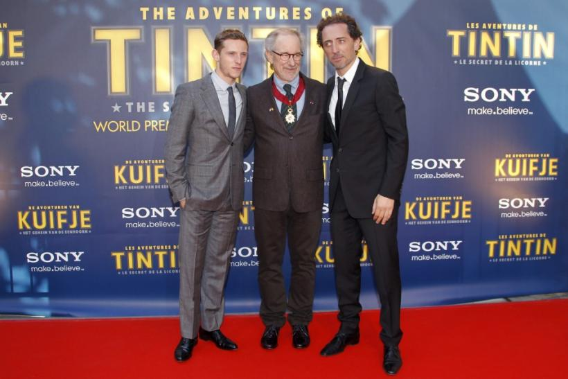 "Director Steven Spielberg poses with actors Jamie Bell (L) and Gad Elmaleh (R) during a photocall ahead of the world premiere of the movie ""The Adventures Of Tintin: The Secret of The Unicorn"" in Brussels October 22, 2011."