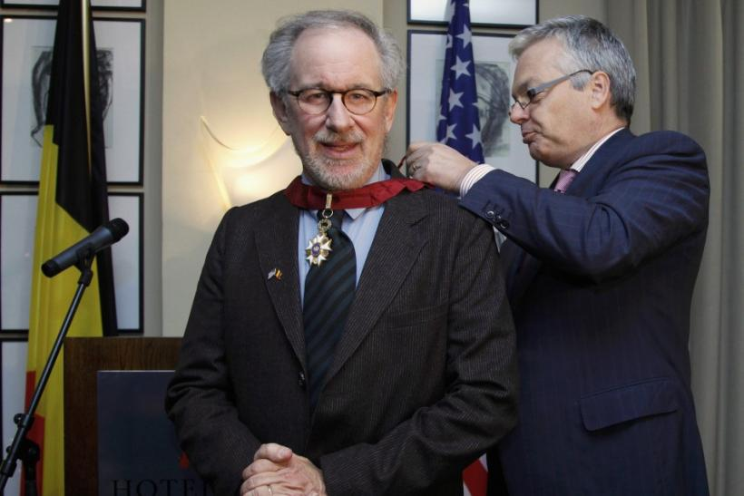 "Director Steven Spielberg (L) receives his Commander of the Order of the Crown decoration from Belgium's Finance Minister Didier Reynders during a ceremony ahead of the world premiere of the movie ""The Adventures Of Tintin: The Secret of The Unicorn&"