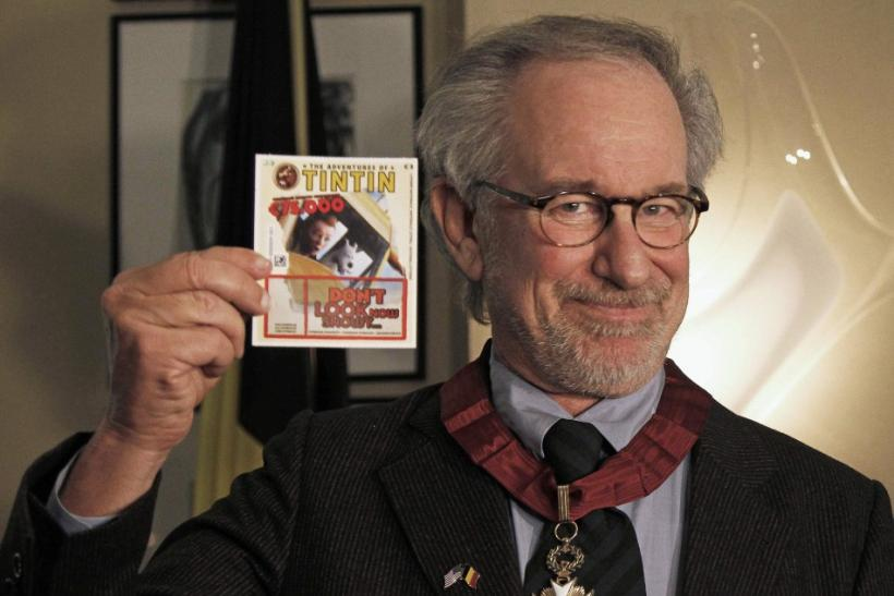 "Director Steven Spielberg shows a Tintin lottery ticket during a ceremony ahead of the world premiere of his movie ""The Adventures Of Tintin: The Secret of The Unicorn"" in Brussels October 22, 2011."