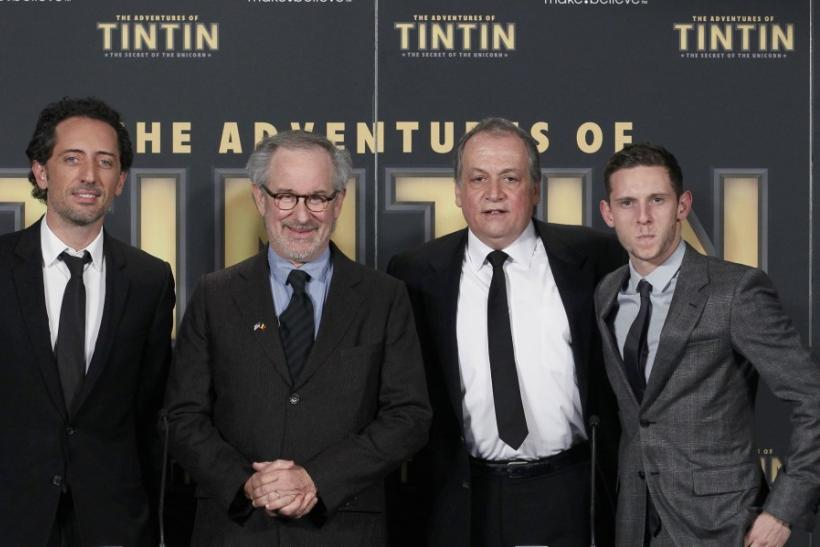 "Director Steven Spielberg poses with actors Gad Elmaleh (L) and Jamie Bell (R) and senior visual effects artist Joe Letteri (2nd R) during a photocall ahead of the world premiere of the movie ""The Adventures Of Tintin: The Secret of The Unicorn"""
