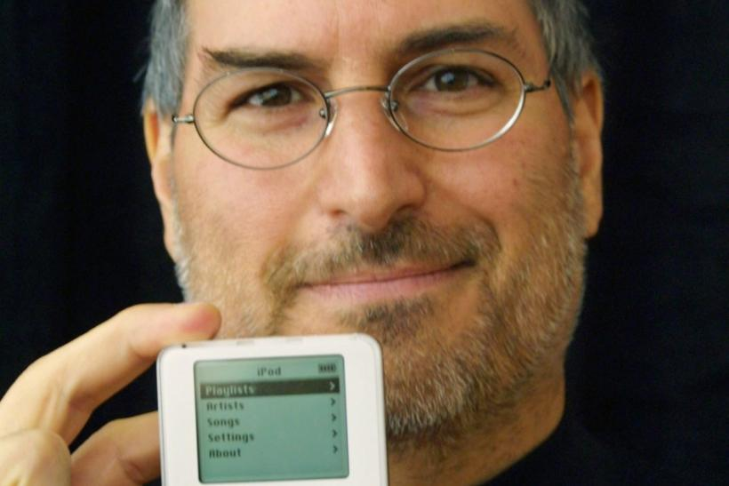 Apple Computer CEO Steve Jobs holds up the new Apple release iPod in Cupertino, California October 23, 2001. The new MP3 iPod music player packs up to 1,000 CD-quality songs into an ultra-portable, 6.5 ounce design that fits in your pocket.