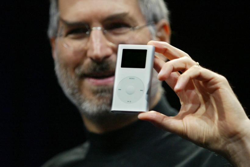 "Apple CEO Steve Jobs introduces the new ""iPod mini"" digital music player at the 2004 Macworld Conference and Expo in San Francisco January 6, 2004."