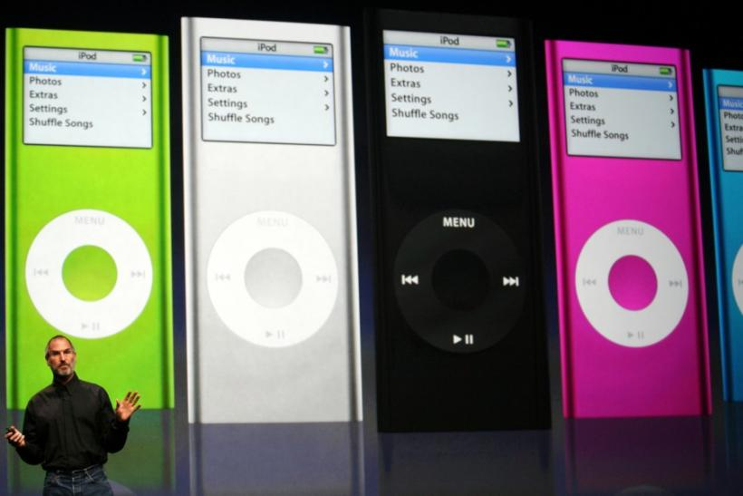 Apple Chief Executive Steve Jobs introduces new iPod Nanos to the crowd at the Yerba Buena Center of the Arts theater in San Francisco, California, September 12, 2006.