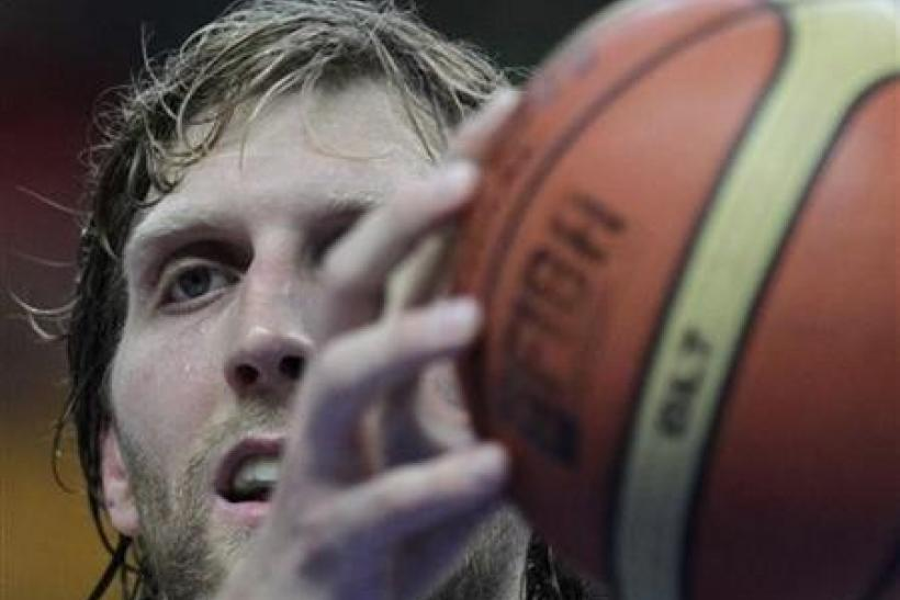 Dirk Nowitzki of Germany holds onto the ball during their FIBA EuroBasket 2011 Group E basketball game against Lithuania in Vilnius