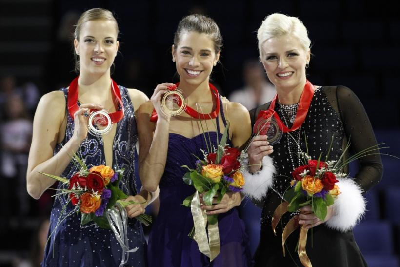Silver medalist Carolina Kostner (L) of Italy, gold medalist Alissa Czisny (C) of the U.S., and bronze medalist Viktoria Helgesson (R) of Sweden pose with their medals during the ladies winners ceremony at the Skate America ISU Grand Prix of Figure Skatin