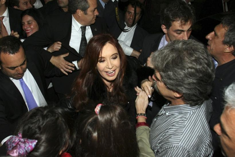 Argentine President Fernandez is greeted by supporters as she arrives at Plaza de Mayo square after winning the nationwide presidential election in Buenos Aires