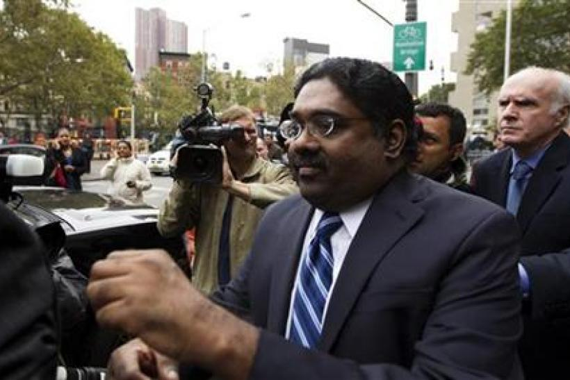 Galleon hedge fund founder Raj Rajaratnam departs Manhattan Federal Court after his sentencing in New York