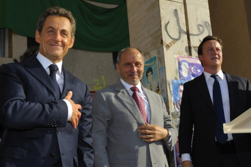 France's President Sarkozy, Britain's Prime Minister Cameron and NTC head Mustafa Abdul Jalil stand together in Benghazi