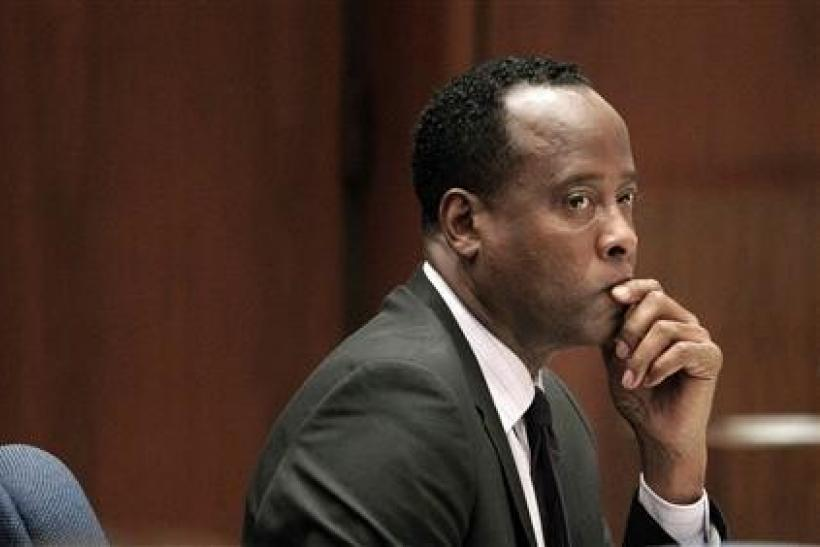 Dr. Conrad Murray sits in a courtroom during his involuntary manslaughter trial in Los Angeles