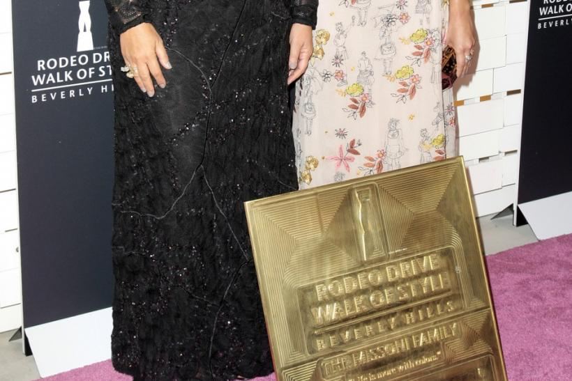 Angela (L) and Margherita Missoni, of the Italian fashion house Missoni, pose with their award at the Rodeo Drive Walk of Style Award honoring Iman and Missoni in Beverly Hills, California