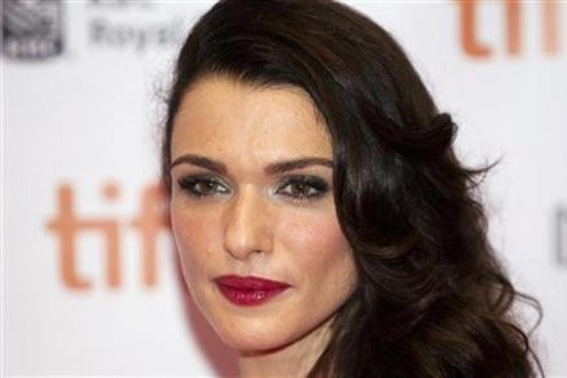 Cast member Rachel Weisz arrives on the red carpet for the film ''The Deep Blue Sea'' during the 36th Toronto International Film Festival (TIFF)