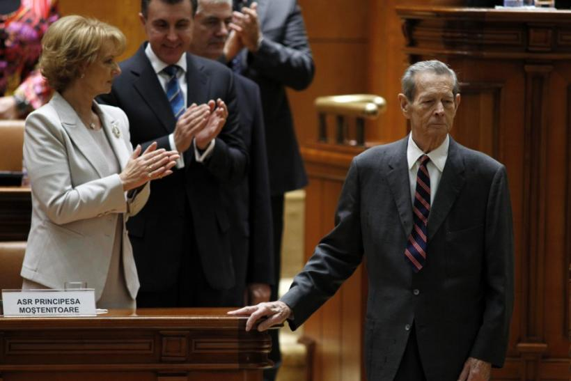 Romania's former King Michael is applauded by his daughter Princess Margarita and Prince Radu after addressing parliament in Bucharest