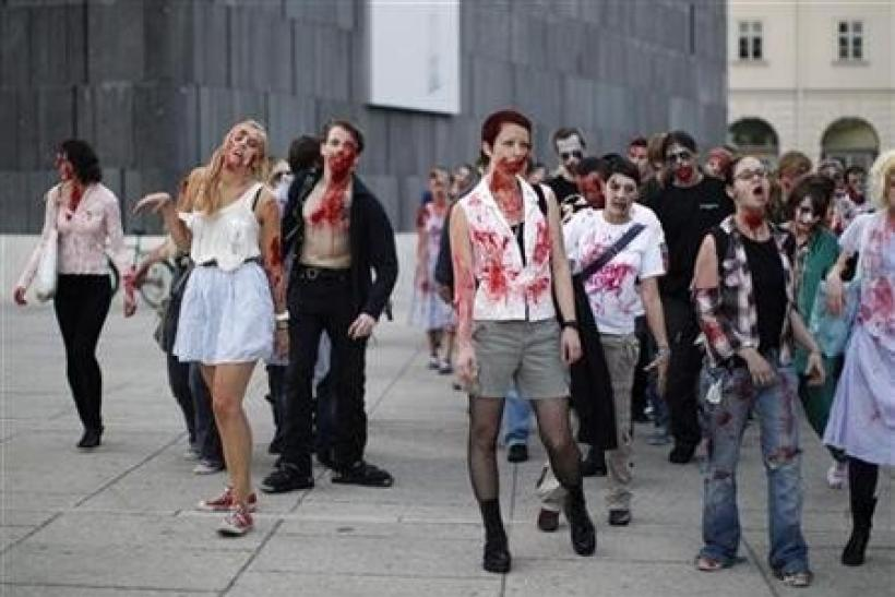 People dressed as zombies take part in a flashmob in Vienna