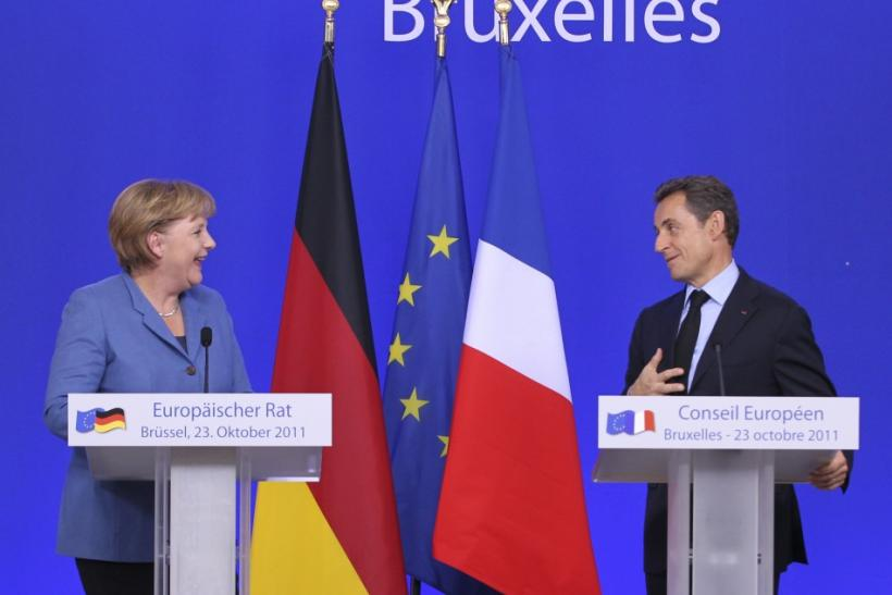 German Chancellor Merkel and France's President Sarkozy hold a joint briefing at the EU summit in Brussels