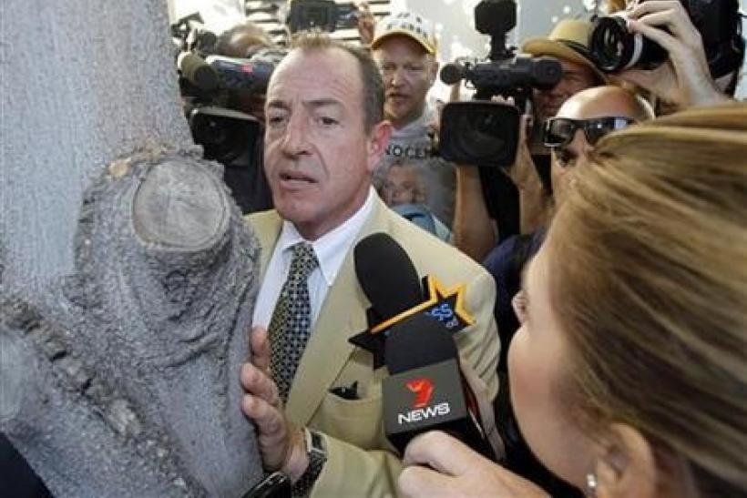 Michael Lohan waits outside the Beverly Hills Courthouse after his daughter Lindsay was denied bail and sent to jail in Beverly Hills, California