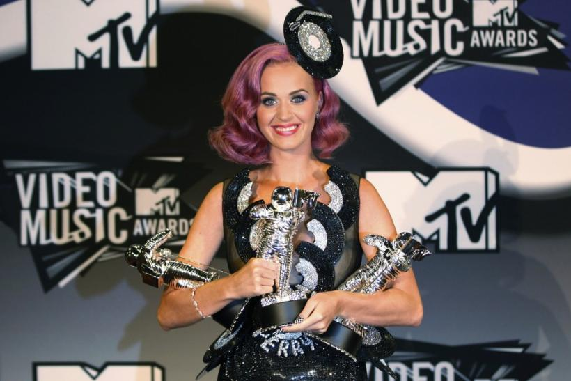 "Perry poses with her three awards, Video of the Year for ""Firework"", Best Collaboration, and Best Special Effects which she won at the 2011 MTV Video Music Awards in Los Angeles"