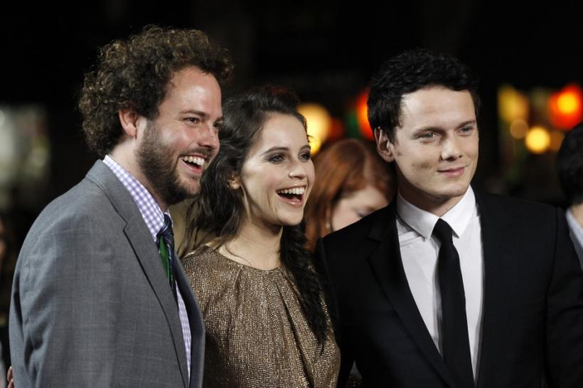 "Director Drake Doremus (L) poses with his cast members Felicity Jones (C) and Anton Yelchin at the premiere of his movie ""Like Crazy"" at the Egyptian Theatre in Hollywood, California"