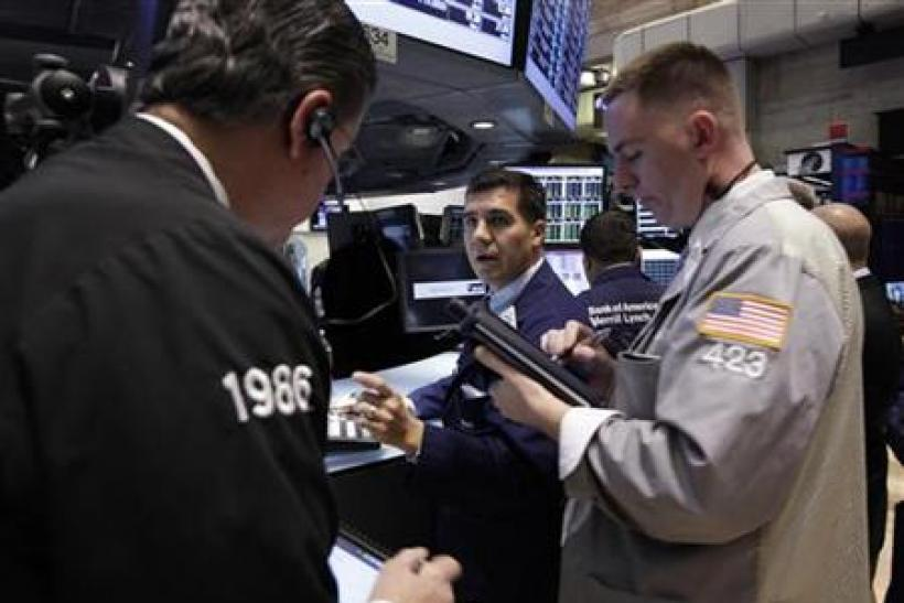 Traders work at the Bank of America trading post on the floor of the New York Stock Exchange