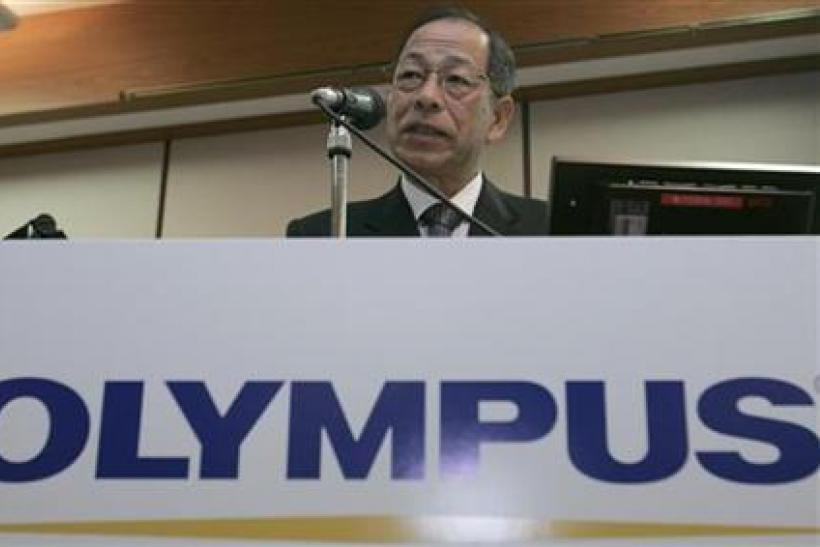 Olympus Corp President Kikukawa speaks during a news conference in Tokyo