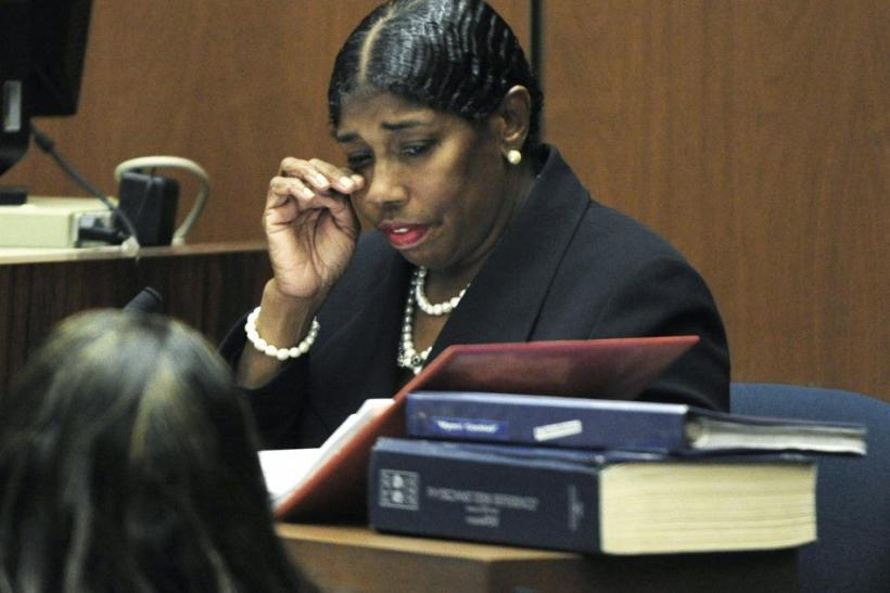 Cherilyn Lee wipes her eyes during testimony during the Dr. Conrad Murray involuntary manslaughter trial in Los Angeles