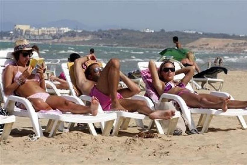 Tourists sunbathe on the beach in Tunisia